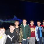 OK Aquarium Shark Tank—Porum GEAR UP students take a quick pic in front of the Shark Tank at the OK Aquarium; Houstin Barnes, Simon Girty, Rawley Killingsworth, Luke Spradlin, Brayden Stinnett, Joey Colbert and Jett Henson